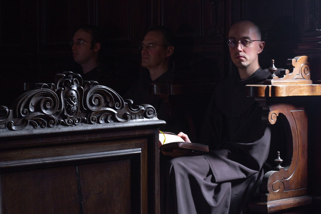 18141-3029-QuaracchiEditions - (from the right) Br Juri Leoni OFM, Br Florian Mair OFM, Br Ryan Thornton OFM.Quaracchi friars at prayer in choir stalls...