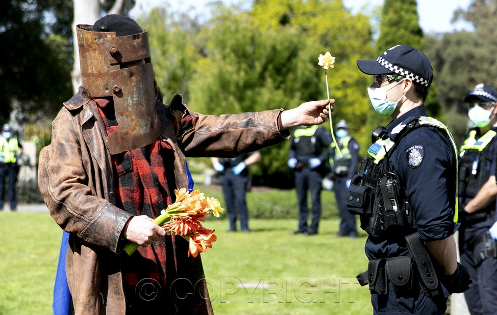 0S9A4352a - MELBOURNE, AUSTRALIA, September 5:  A man dressed as Ned Kelly taunts the police before being fined for not wearing a mask. Anti lockdown protesters...