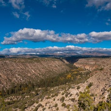 Bandelier National Monument - The remains of cliff houses and villages of Pueblo Indians from the 1200s are protected on mesa tops and canyon walls of...