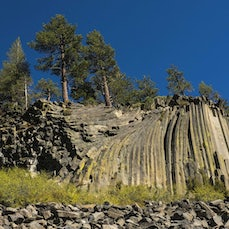 Devil's Postpile National Monument, California - A spectacular example of columnar basalt, 101-foot high Rainbow Falls, and pristine mountain scenery make...