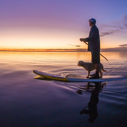 Sunrise paddle, Moreton Bay - Best friends paddle together, gliding into nature as the sun rises over Moreton Bay.