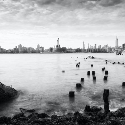 NYC - East River in all it's gritty glory - The view from Brooklyn over the East River towards Manhattan at dawn