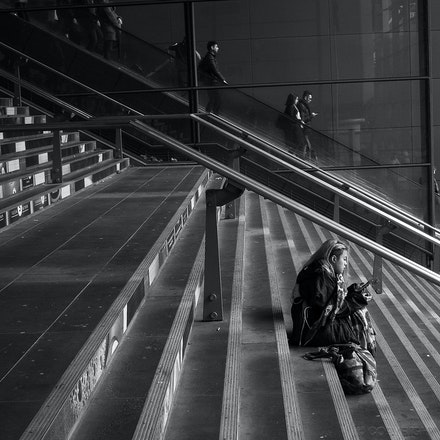 Southern Cross Railway Station - A girl sits on the steps at Southern Cross railway station, Melbourne