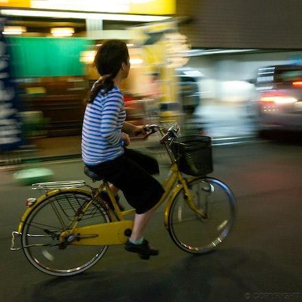 Osaka Woman On Bike - Woman negotiating the back streets of Osaka, Japan