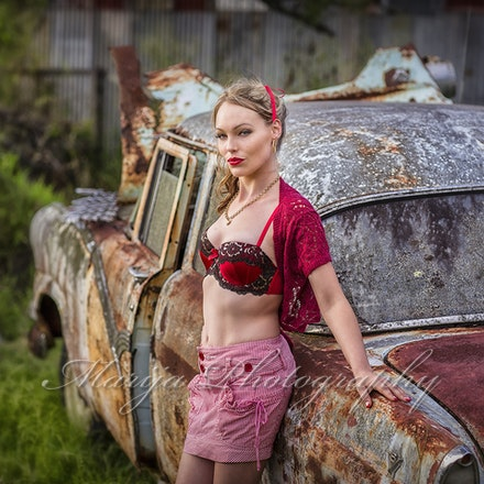 Millie standing with rusty car-Edit