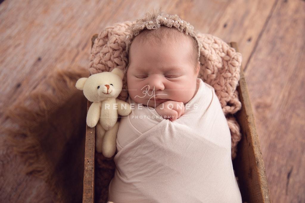 Newborn in a rustic crate - Brisbane Newborn Photographer - Newborn baby girl in a rustic timber crate. Brisbane Newborn Photographer