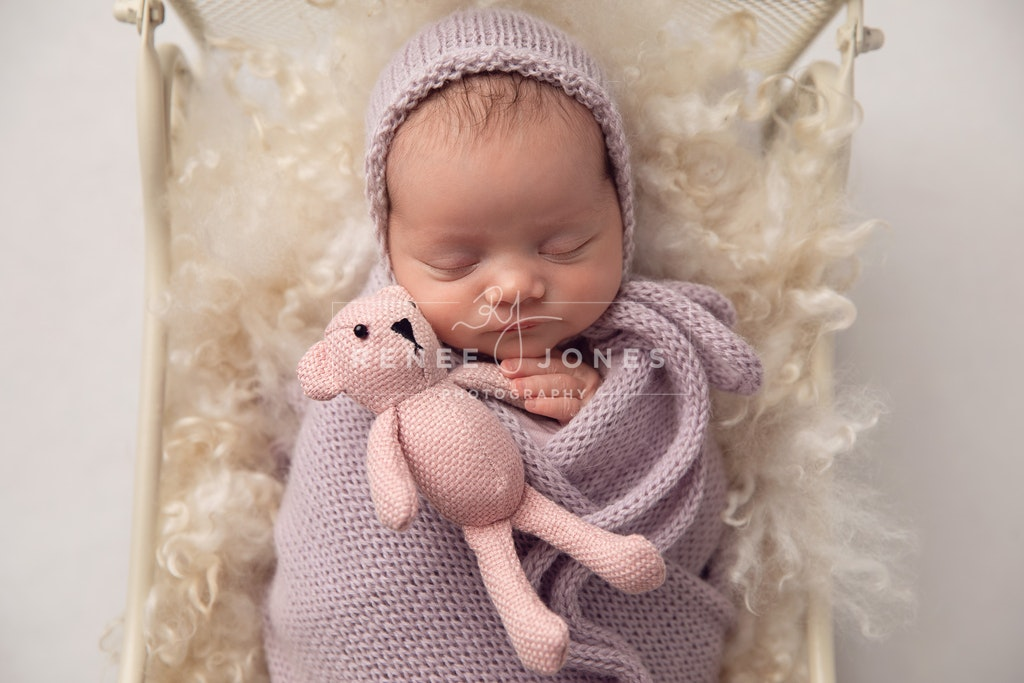Newborn - Brisbane Baby Photographer - sleeping newborn wrapped in purple with a teddy