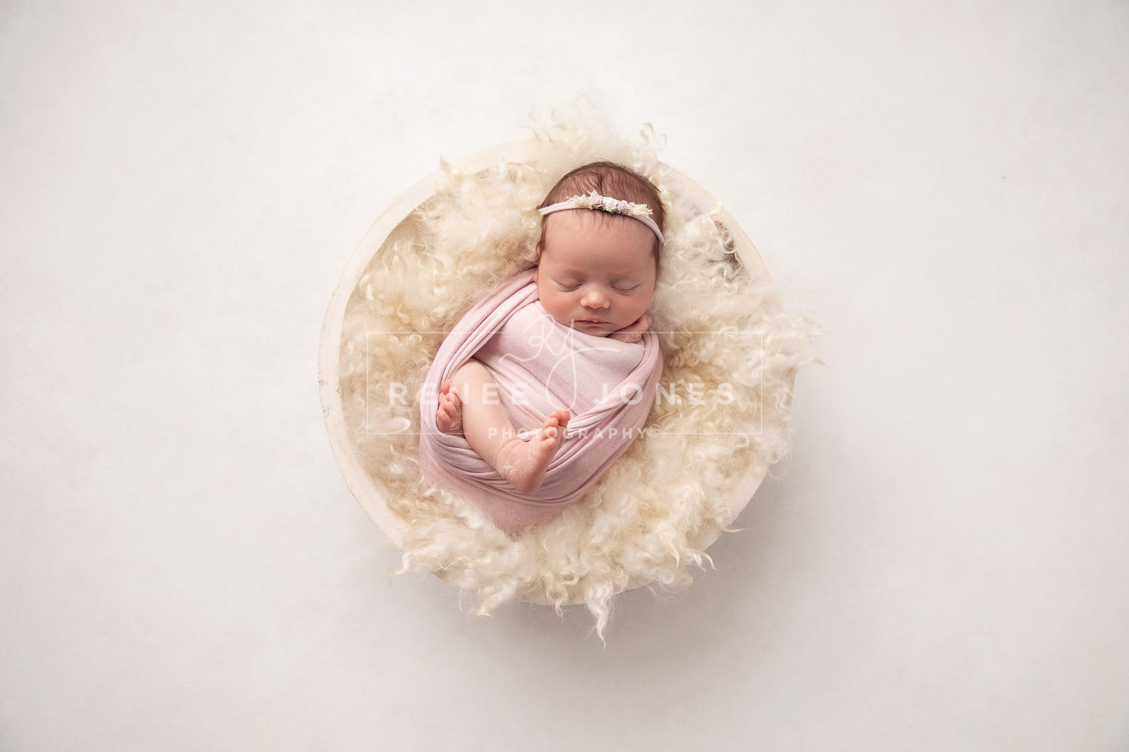 Newborn 2 - Brisbane Newborn Photographer - Baby wrapped and curled in a wooden bowl