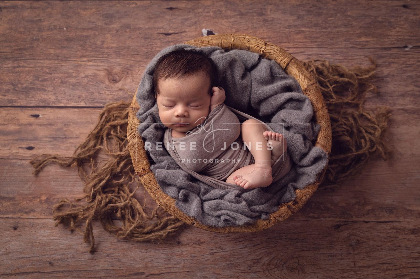Newborn Baby - Brisbane Baby Photographer - Newborn posed in a round wooden bowl