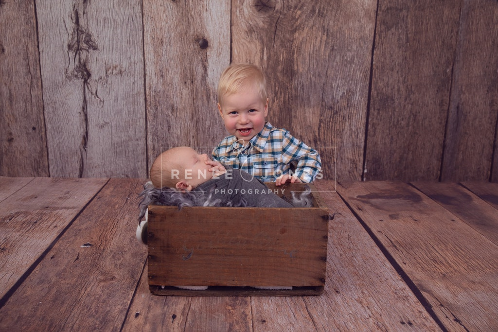 My Big Brother - Brisbane Newborn Photographer - Newborn sleeping in a rustic crate with his big brother