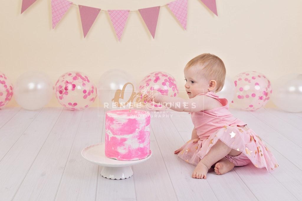 Imogen's Cake Smash 1 - Brisbane Cake Smash Photographer - First birthday cake smash. Brisbane Cake Smash Photographer