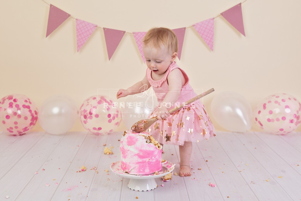 Imogen's Cake Smash 4 - Brisbane Cake Smash Photographer - Child standing and smashing a cake. Brisbane Cake Smash Photographer