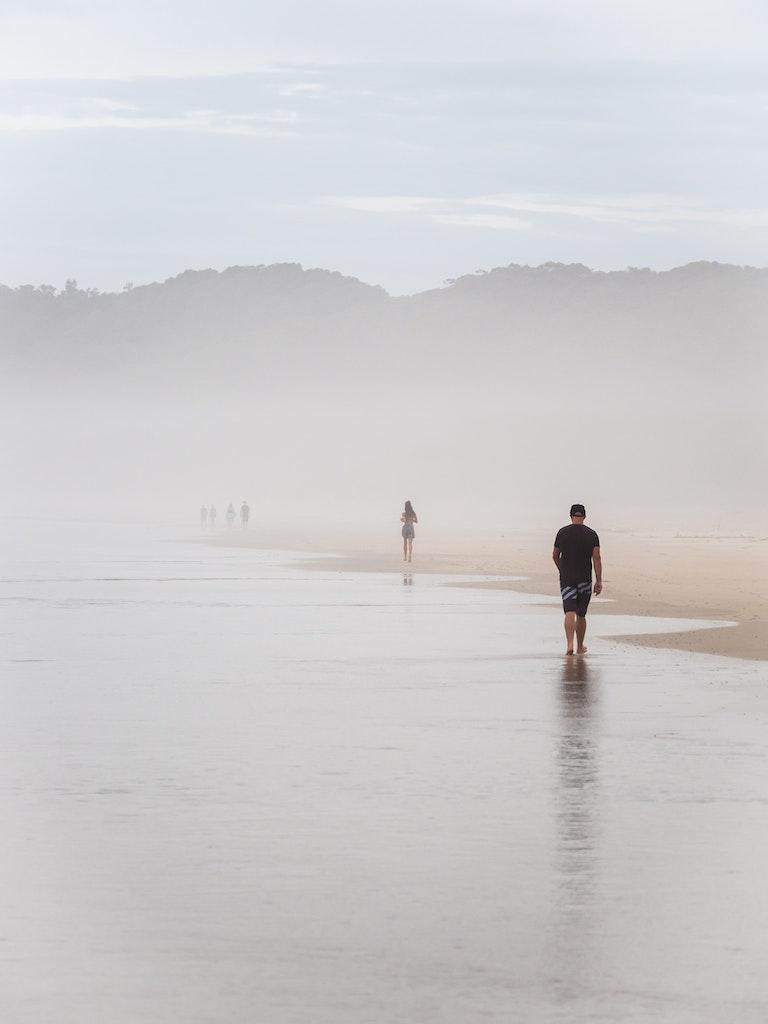 Byron Bay - Figures in the Mist - Early morning beach walkers move through sea mist at Suffolk Park beach, near Byron Bay.