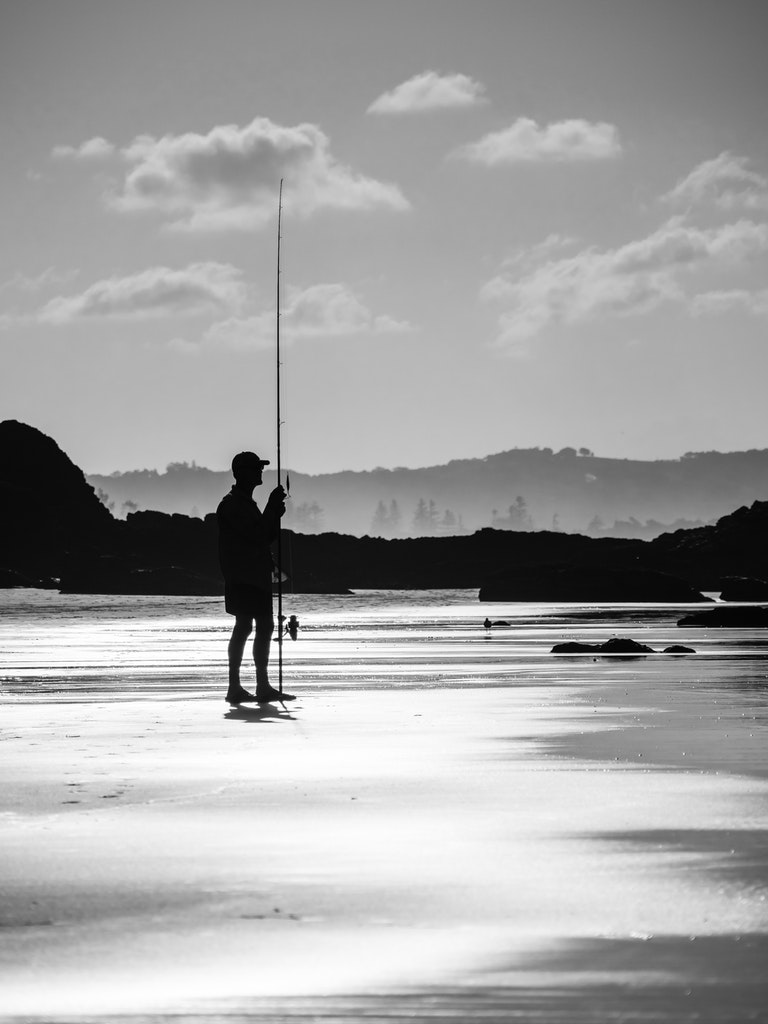 Byron Bay Fisherman - A fishermen ponders the conditions at Wategos Beach in Byron Bay.