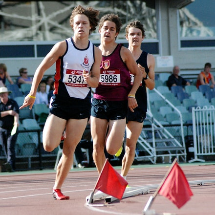 1500m - Kane Grimster, Jordan Williamsz and Ryan Geard kick down over the final lap of the 1500m at the 2009 Victorian ALl School Championships at Olympic...