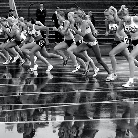 1500m start - A black and white photo of the rain drenched track that greeted athletes in the 1500m at the 2009 Zatopek:10 meet.