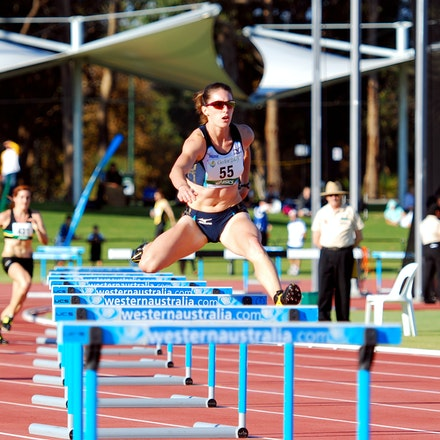 Lauren Boden - Lauren Boden clears a barrier in the heats of the 400m hurdles at the 2010 Australian Championships in Perth. Boden would easily win the...