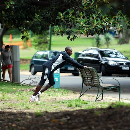 Kenyan stretch - An athlete stretches on a bench adjacent to The Tan in Melbourne ahead of the 2011 World Athletics Tour meet.