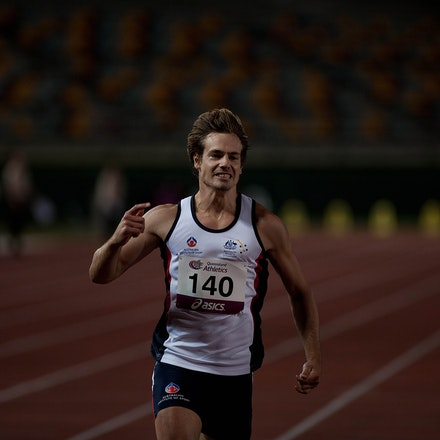 Evan O'Hanlon - Evan O'Hanlon celebrates after winning the AWD 200m at the 2013 Queensland Track Classic.  Photo: Chris Lew