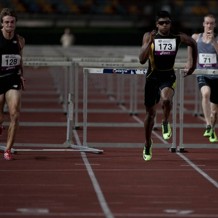Sprint hurdles - India's Siddhanth Thingala runs strongly off the final hurdle to take line honours in the 110m H from Justin Merlino at the 2013 Queensland...
