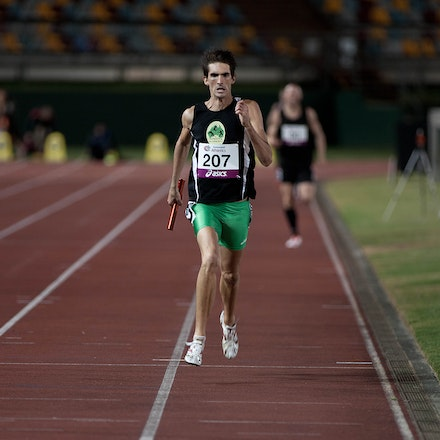 Matt Lynch - Matt Lynch, wearing an Athletes Australia singlet, strifes to the line on the anchor leg of the 4x400m at the 2013 Queensland Track Classic....