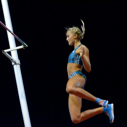Liz Parnov - Liz Parnov celebrates a clearance as she falls back to the ground in the pole vault at the 2014 Sydney Track Classic.