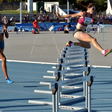 Lauren Wells - Lauren Wells clears the eighth hurdle in the 400m hurdles at the 2015 Melbourne Track Classic at Lakeside Stadium.