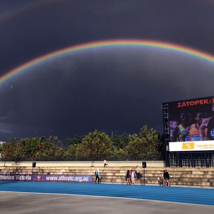Double rainbow - Rainbows form over the scoreboard at Lakeside Stadium with a storm set to affect the annual Zatopek:10 meet in 2016.