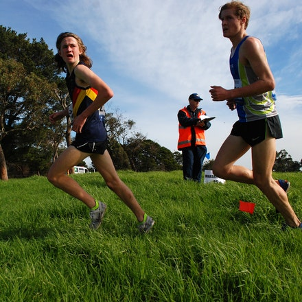 Liam Cashin - Liam Cashin glances over his shoulder at the field behind him in the U18 6km at Cruden Park.