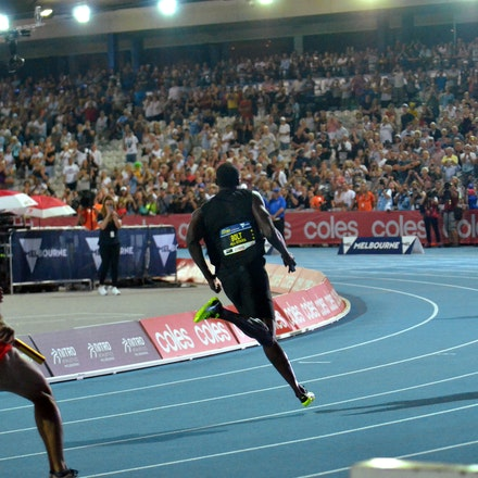 Bolt around the bend - Usain Bolt shows the rest of the field a clean pair of heels during the third leg of the mixed 4x100m at the second round of Nitro...