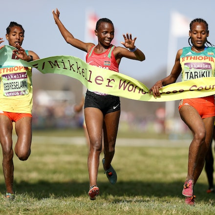 Junior Women's Finish - Beatrice Chebet of Kenya (C) crosses the line to win the Women's U20 Final as Alemitu Tariku of Ethiopia (R) reacts to coming second...