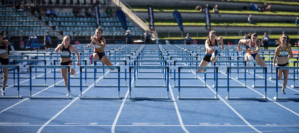 Hurdles - Celeste Mucci clears the final hurdle along with Michelle Jenneke and Brianna Beahan on her way to victory at the 2019 Australian Championships...