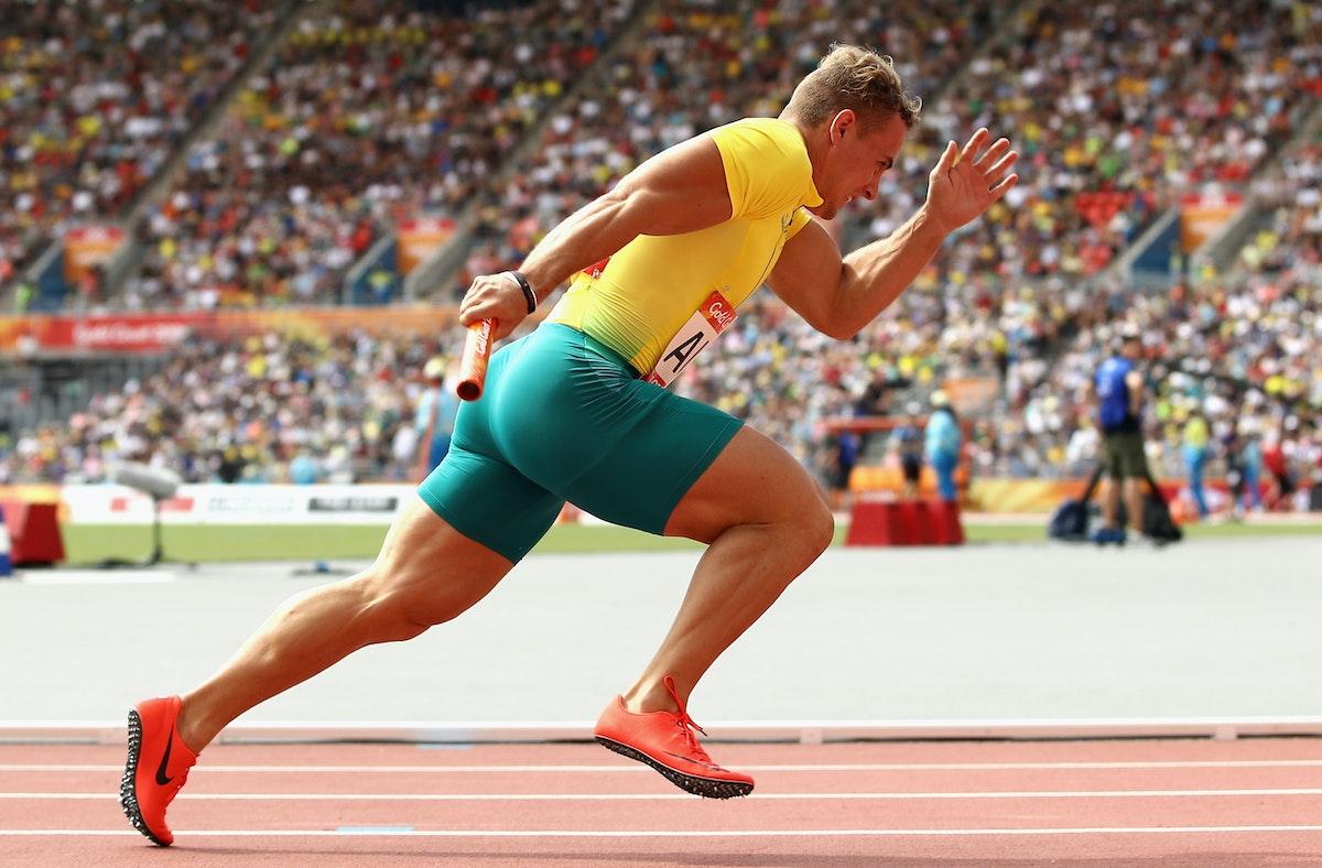 945512882 - GOLD COAST, AUSTRALIA - APRIL 13:  Trae Williams of Australia leaves the blocks at the start of the Men's 4x100 metres relay heats during Athletics...