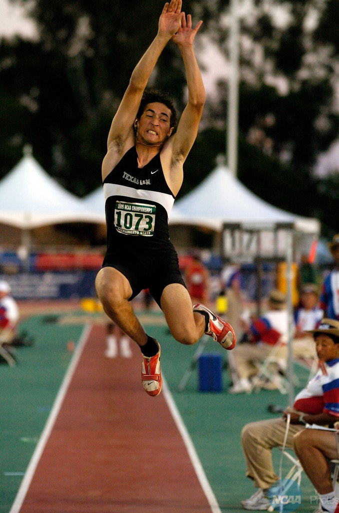 M1TRAK05 - 09 JUNE 2005: Fabrice Lapierre (1073) of Texas A&M won the men's long jump with this 26-9 jump during the Division 1 Track and Field Championship...
