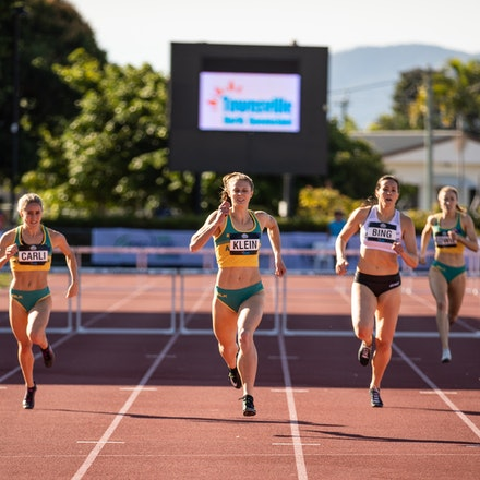 Sara Klein - Sara Klein on her way to a new personal best of 56.07 seconds, and victory, at the 2019 Oceania Championships in Townsville. Photo by Casey...