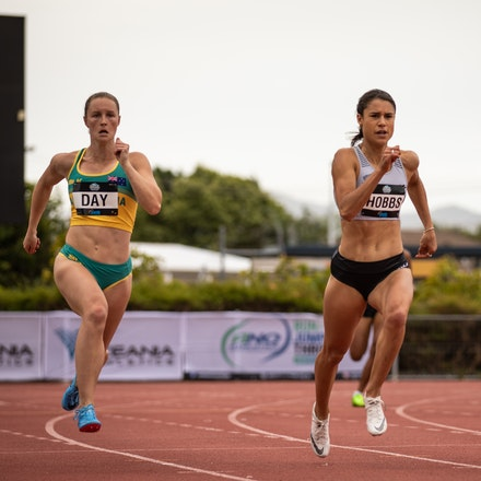 Riley Day - Riley Day on her way to victory in the 200m at the 2019 Oceania Championships in Townsville. Photo by Casey Sims.