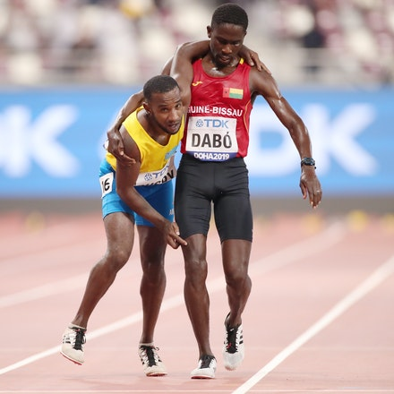 17th IAAF World Athletics Championships Doha 2019 - Day One - DOHA, QATAR - SEPTEMBER 27: Braima Suncar Dabo of Guinea-Bissau helps Jonathan Busby of Aruba...