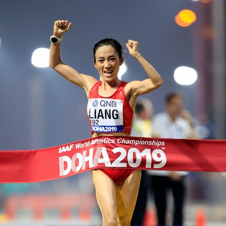17th IAAF World Athletics Championships Doha 2019 - Day Two - DOHA, QATAR - SEPTEMBER 28:  Rui Liang of China crosses the finish line winning the Women's...
