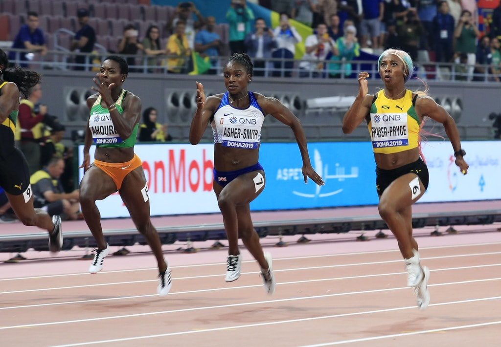 17th IAAF World Athletics Championships Doha 2019 - Day Three - DOHA, QATAR - SEPTEMBER 29: Dina Asher-Smith of Great Britain and Shelly-Ann Fraser-Pryce...