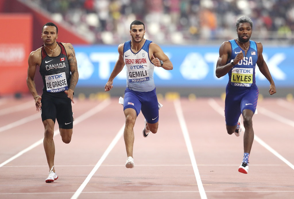 17th IAAF World Athletics Championships Doha 2019 - Day Five - DOHA, QATAR - OCTOBER 01: (L-R) Andre De Grasse of Canada, Adam Gemili of Great Britain...