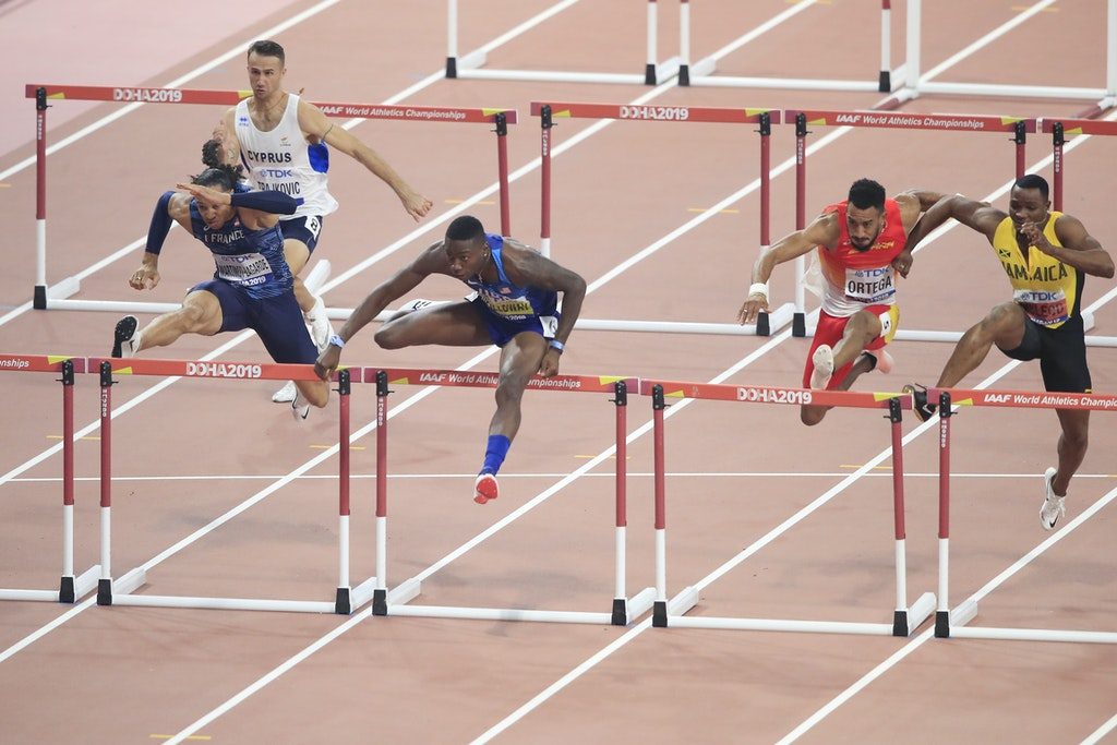 17th IAAF World Athletics Championships Doha 2019 - Day Six - DOHA, QATAR - OCTOBER 02: Grant Holloway of the United States competes in the Men's 110 metres...