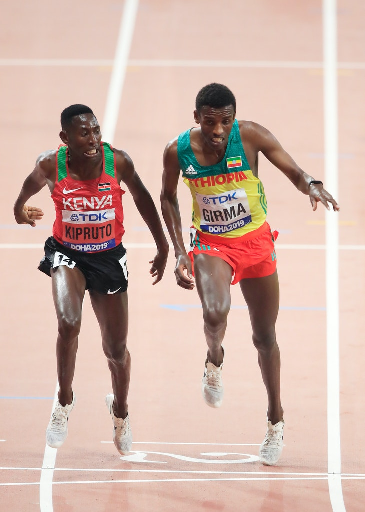 17th IAAF World Athletics Championships Doha 2019 - Day Eight - DOHA, QATAR - OCTOBER 04: Conseslus Kipruto of Kenya, gold, and Lamecha Girma of Ethiopia,...