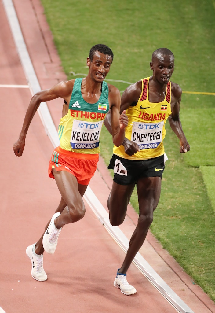 17th IAAF World Athletics Championships Doha 2019 - Day Ten - DOHA, QATAR - OCTOBER 06: Joshua Cheptegei of Uganda, gold, competes with Yomif Kejelcha...