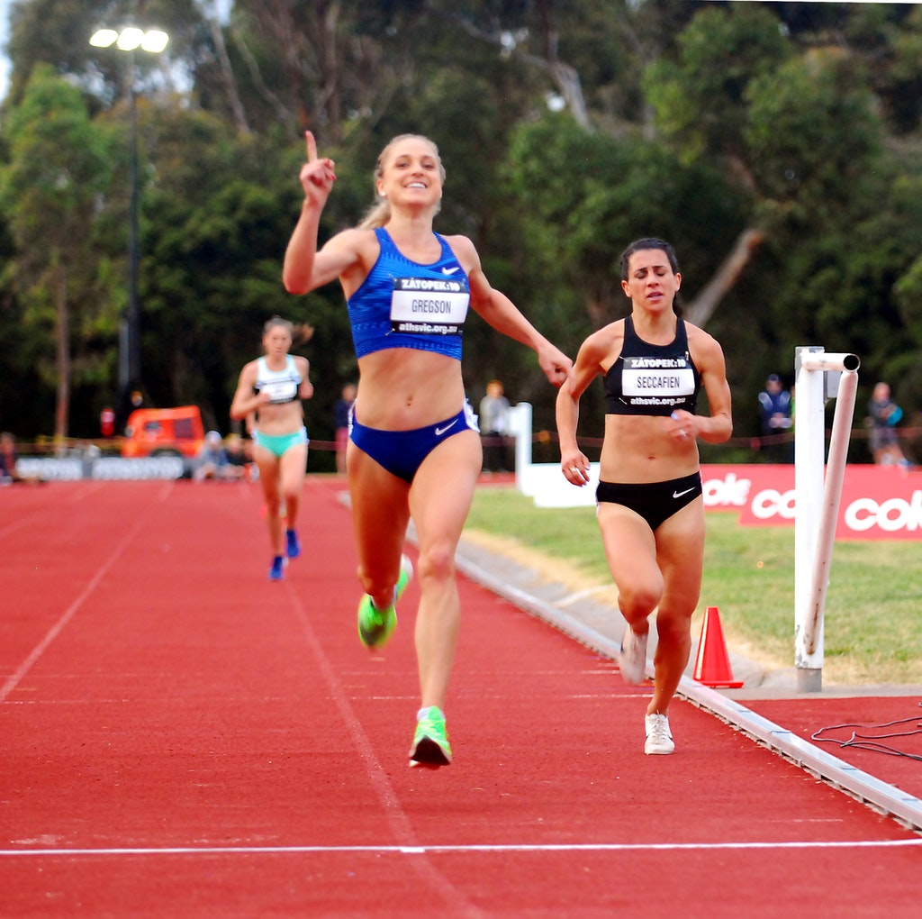 Gregson wins - Genevieve Gregson crosses the line for victory in the 10000m at the 2019 Zatopek:10 meet at Box Hill.
