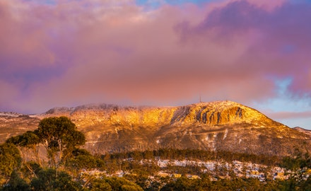 Mount Wellington Winter sunrise - Hobart's Mount Wellington under heavy snow catches the warming golden light of sunrise.