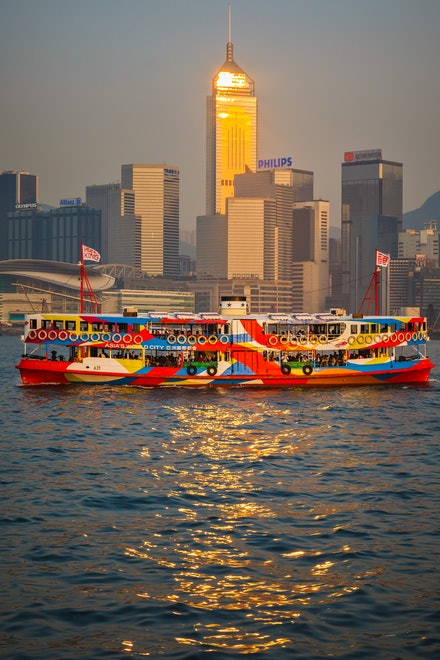 Star Ferry Golden Glow - The late afternoon sun gleams from the Central Plaza Skyscraper in Wanchai district as the Star Ferry 'Night Star' makes another...