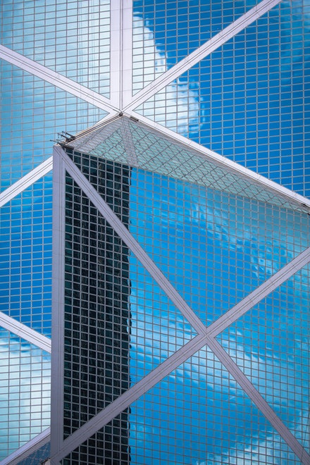 Bank of China Tower reflections - The triangular glass skyscraper of the Bank of China is a stunning example of modern architecture. Currently the fourth...