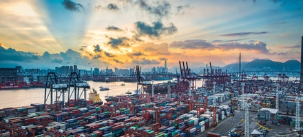 Hong Kong port sunrise - Hong Kong is one of the worlds busiest seaports. This view is of sunrise over massive the Kwai Tsing Container terminals.