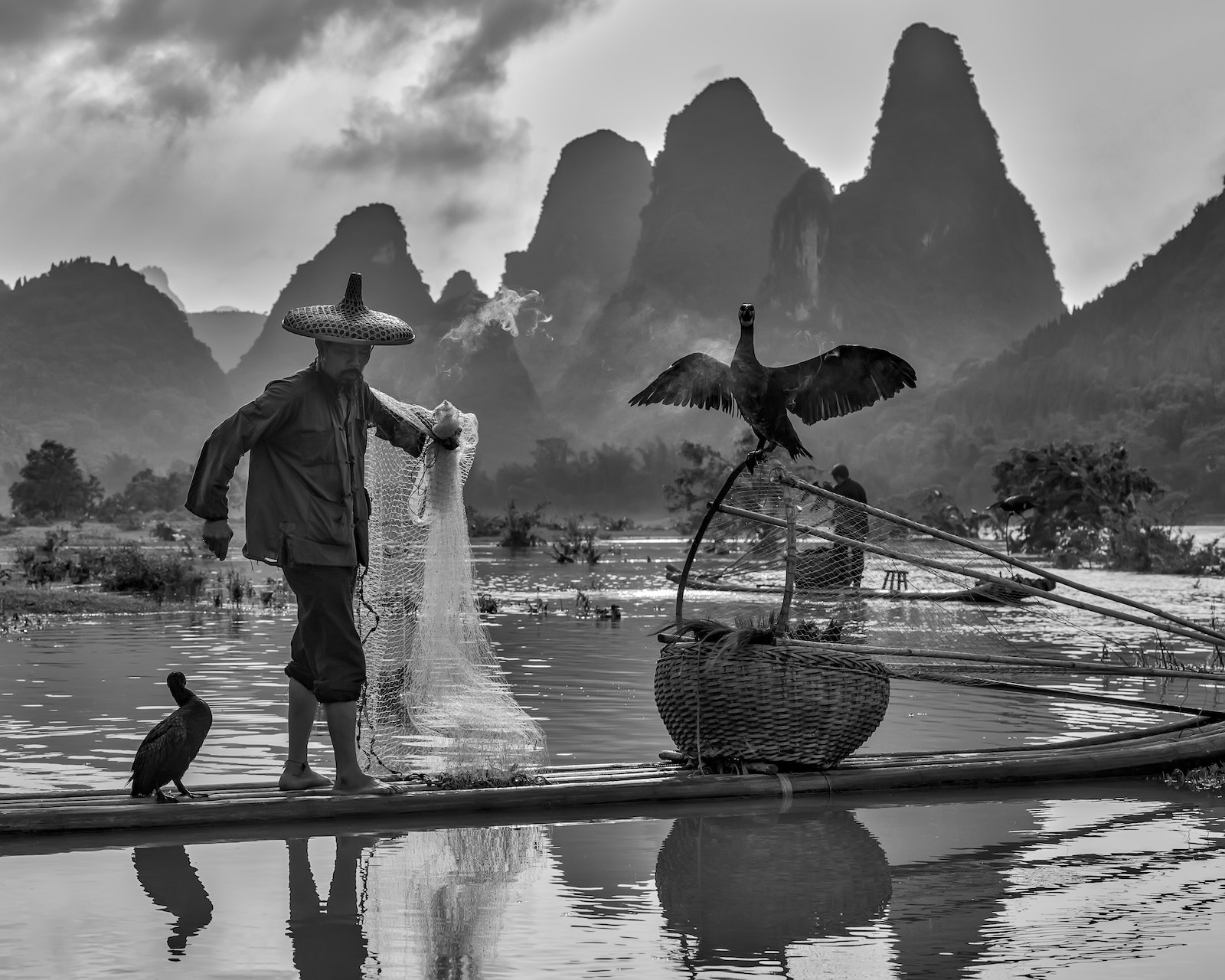 Portrait of a Fisherman - The cormorant fishermen of the Li River offer a glimpse into days gone by. The amazing karst landscape offers the spectacular...
