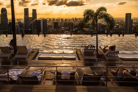 Sunset at Marina Bay - Another day draws to a close at the spectacular infinity pool atop the Marina Bay Sands Resort in Singapore. Available only to guests...